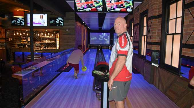 KNOCK 'EM DOWN: Publican Wayne Goodwin checks out the new bowling lanes at the Alley Bar at Kyogle's Commercial Hotel.