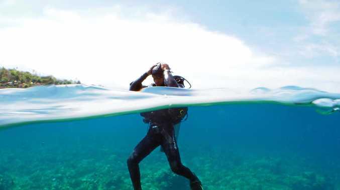 DIVE IN: Kari prepares to guide us on a dive at Jemeluk Drop Off in Amed, Bali.