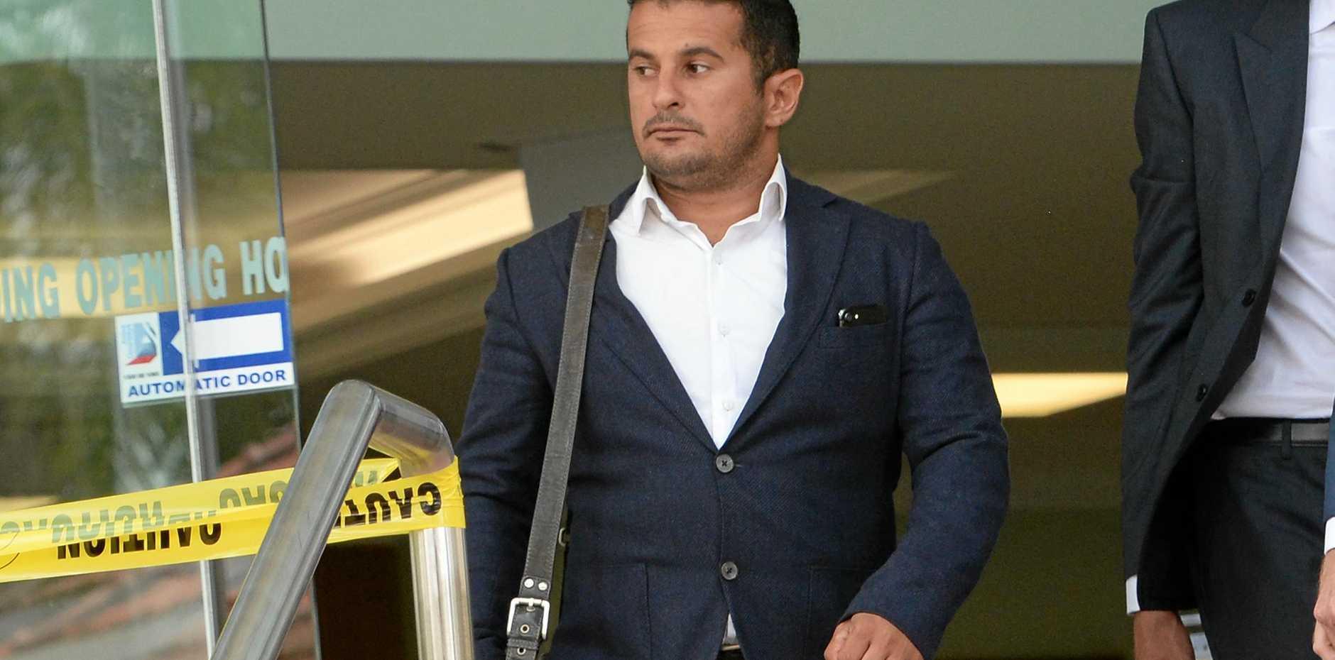 DOCUMENTS WIN: Petros Khalesirad leaving the Rockhampton Courthouse.