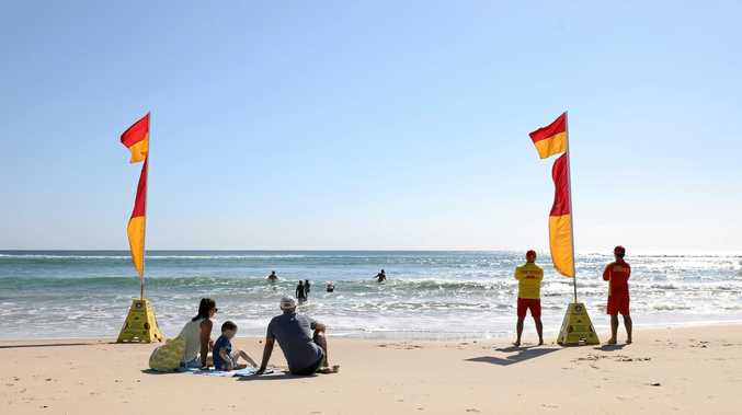 An 18-year-old woman has been pulled from the surf at Coolum Beach.