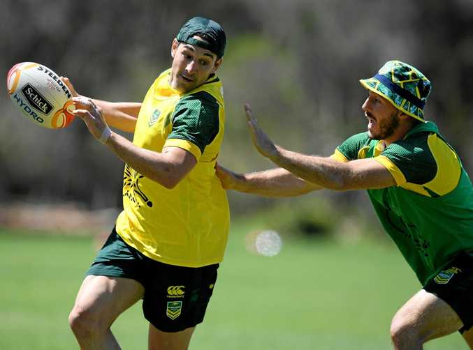 Billy Slater (left) tries to evade Kangaroos teammate Ben Hunt during a training run.