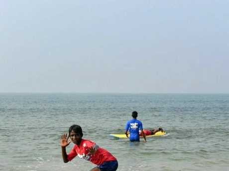STYLIN': Some of Jamo's students in India enjoying the surf.