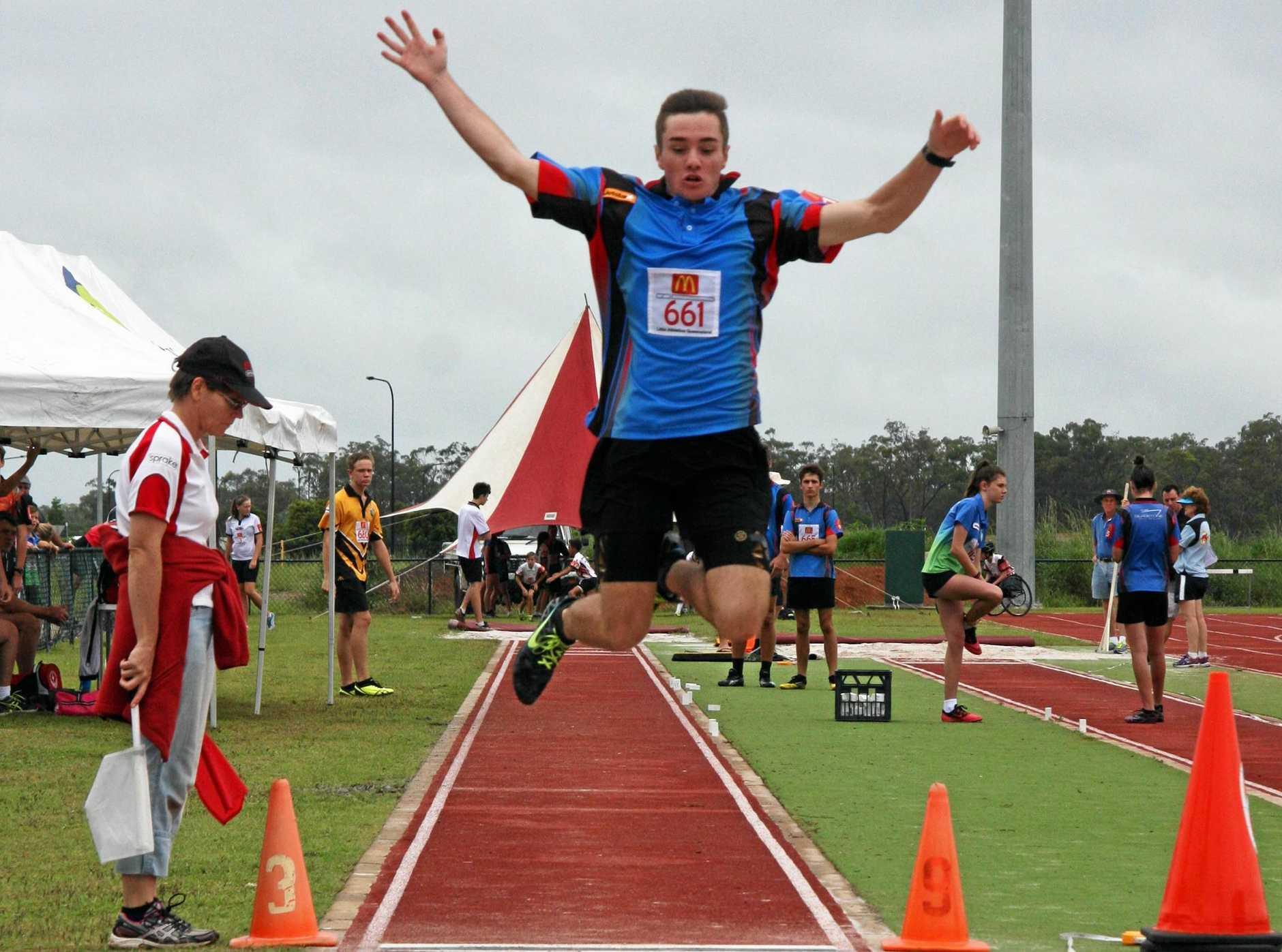 LEAP: Ryan Neale puts in a massive effort in the long-jump.