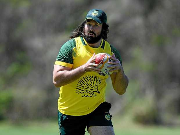 Aaron Woods warms up ahead of a Kangaroos training session.