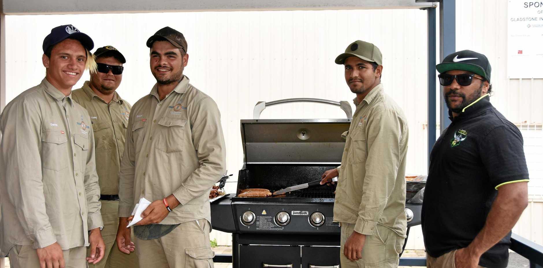 CELEBRATION: Graduates Darren Hodges, Toby Flinn (Sea Ranger) Shayde Fisher, Brandon Gilchrist and Luke Bond, earned themselves a barbecue.
