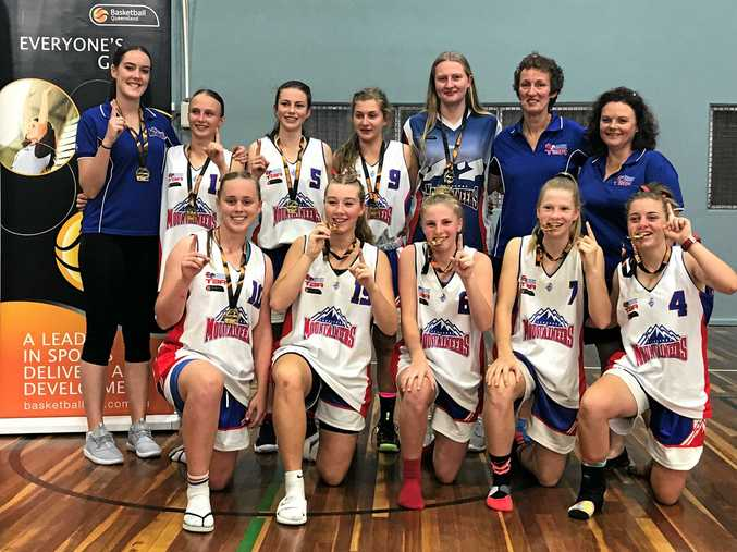 CUP WINNER: Celebrating their Basketball Queensland Southern Cup grand final win are under-18 Toowoomba Mountaineers players (back, from left) Emily Derksen (assistant coach), Ashleigh Conway, Morgan Prentice, Courtney Edmondstone, Phoebe Hinz, Chree Derksen (coach), Chris O'Connell (manager), (front, from left) Claudia Ott, Ali Baker, Katey Holt, Katey McHugh and Abbey Markey.