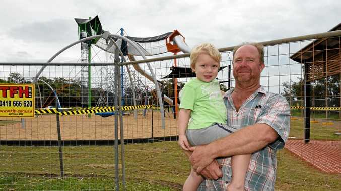 PARK OPENS: David Ewenson with his son Kieran outside the Pialba Adventure Playground yesterday.