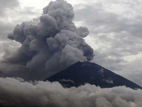 Clouds of ashes rise from the Mount Agung volcano erupting in Karangasem, Bali.