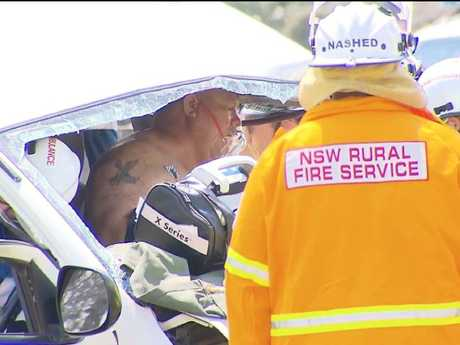 The minibus driver was trapped for more than an hour before he was freed. Picture: John Tesoriero