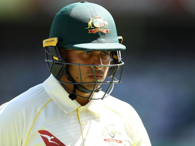 A dejected Usman Khawaja leaves the field after falling to spin at the Gabba.