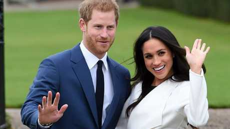 Prince Harry and Meghan Markle pose for the media in the grounds of Kensington Palace, London. Picture: Eddie Mulholland/Pool via AP