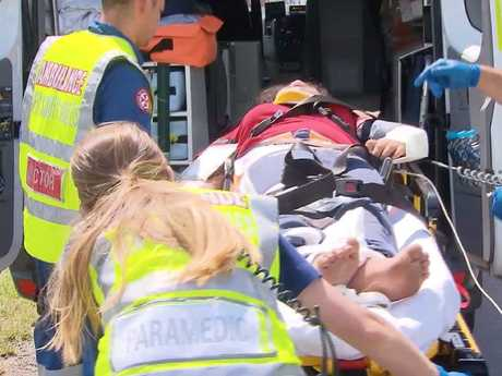 One of the injured passengers being loaded into the ambulance. Picture: John Tesoriero