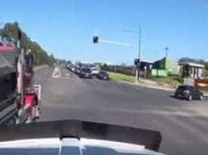 DASH CAM: 'Cowboy truckie' runs red light, cuts off truck