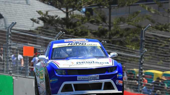 AIR: Bundaberg's Kel Treseder flies around the Newcastle street circuit in the Aussie Racing Cars.