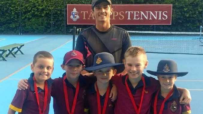 Red Ball Toowoomba Tennis winners, the Gold team (front from left) Daniel Beits, Delan Zimmerle, Harry Sanson, Blake Best, Tom Rawlings with court supervisor Alex Crook.