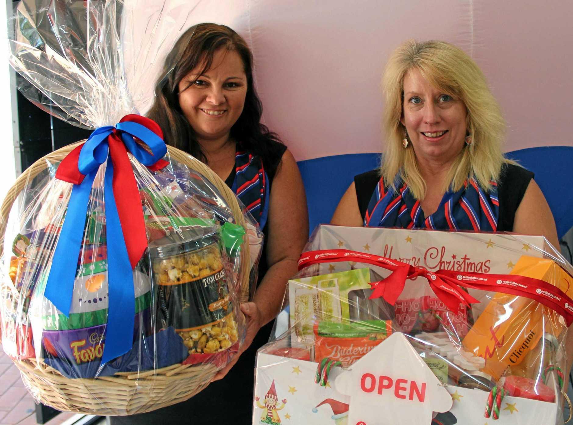 FAMILY FUN: RE/MAX Partners Hervey Bay sales associate Raelene Box and administration assistant Margie Bergman.