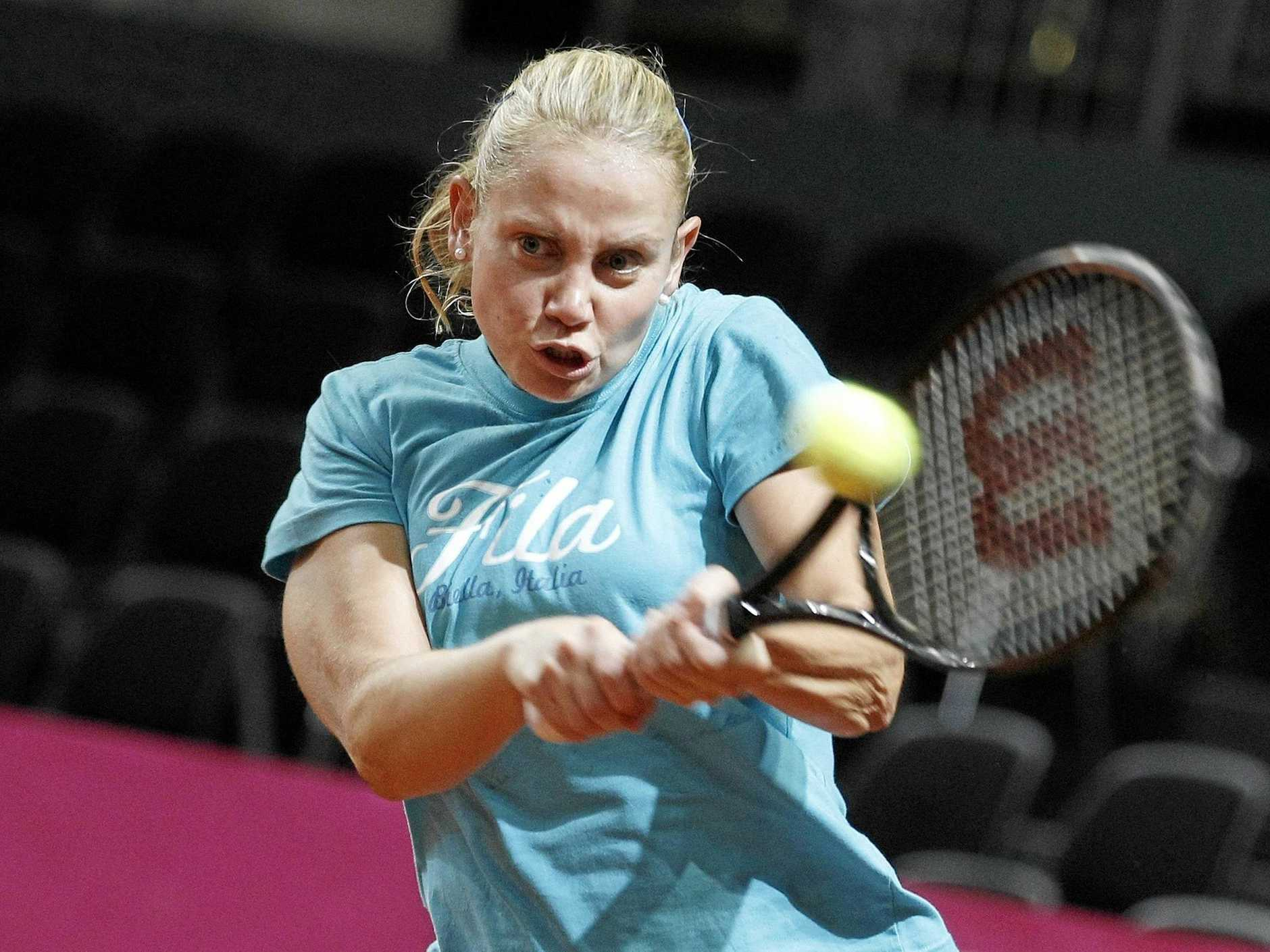 Australia's Fed Cup tennis player Jelena Dokic returns a ball during a training session in the Forum Arena in Fribourg, Switzerland, Wednesday, Feb. 1, 2012.