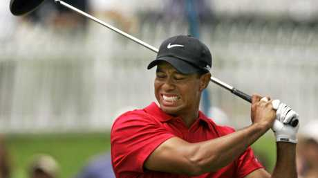Tiger Woods grimaces with pain after playing a shot during his attempted return to competition last year.
