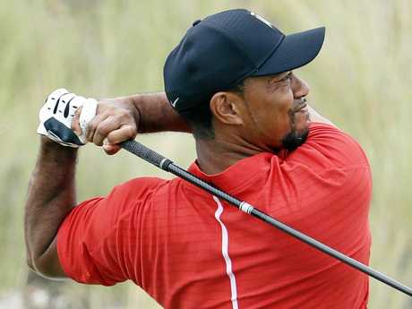 Tiger Woods hits a tee shot at the Albany Golf Club in the Bahamas.