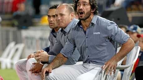 Injured Cowboys Matthew Scott and Johnathan Thurston watch from the sideline.