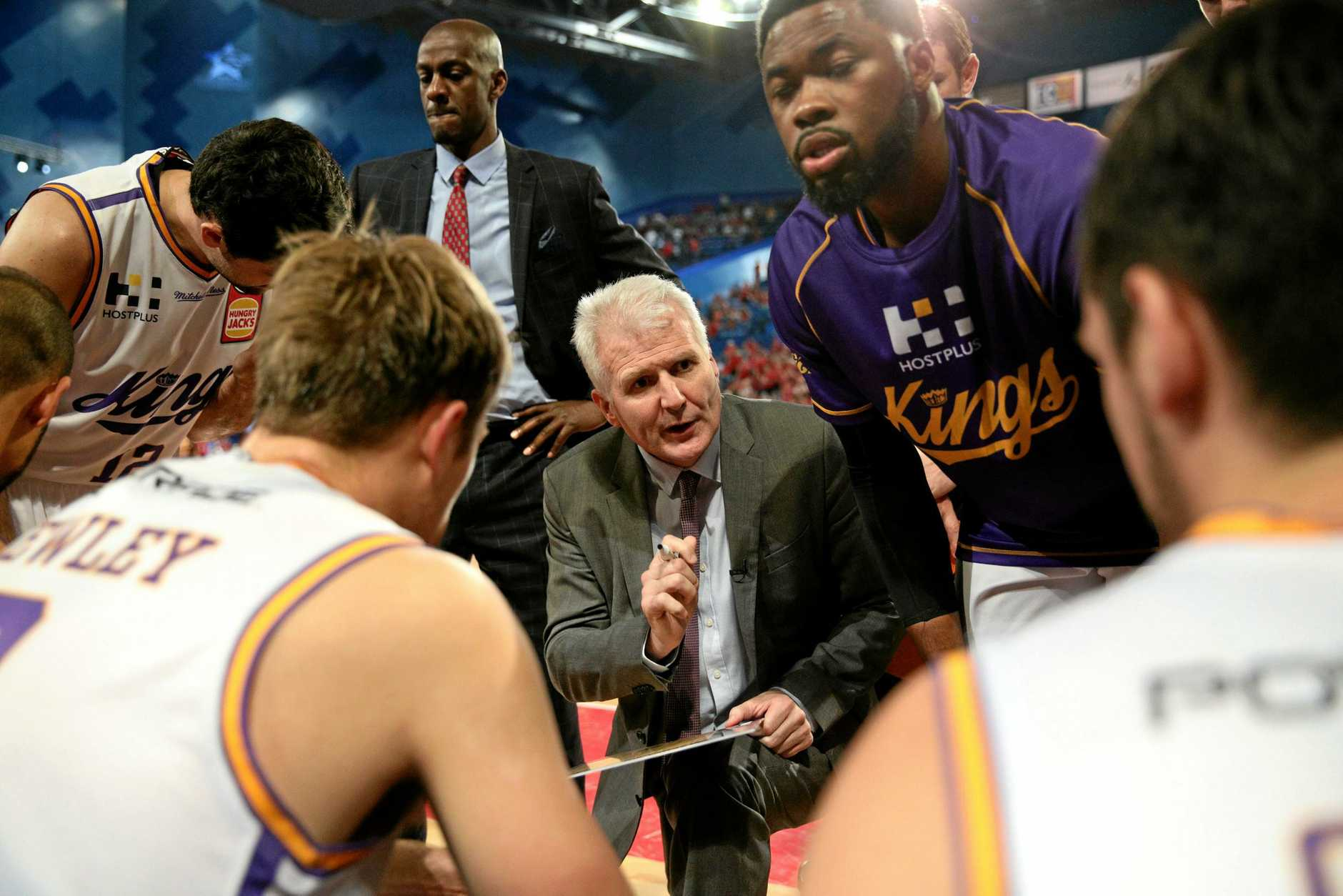 Andrew Gaze talks to the Sydney Kings players during a break in play.