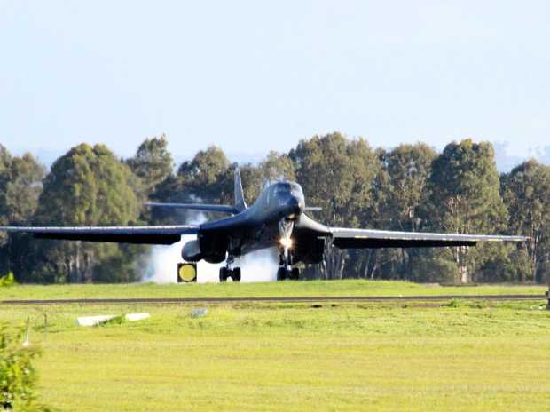 WELCOME: Local enthusiast Tom Fisher captured these images of the US Air Force Lancer Bomber landing at Amberley on Tuesday.
