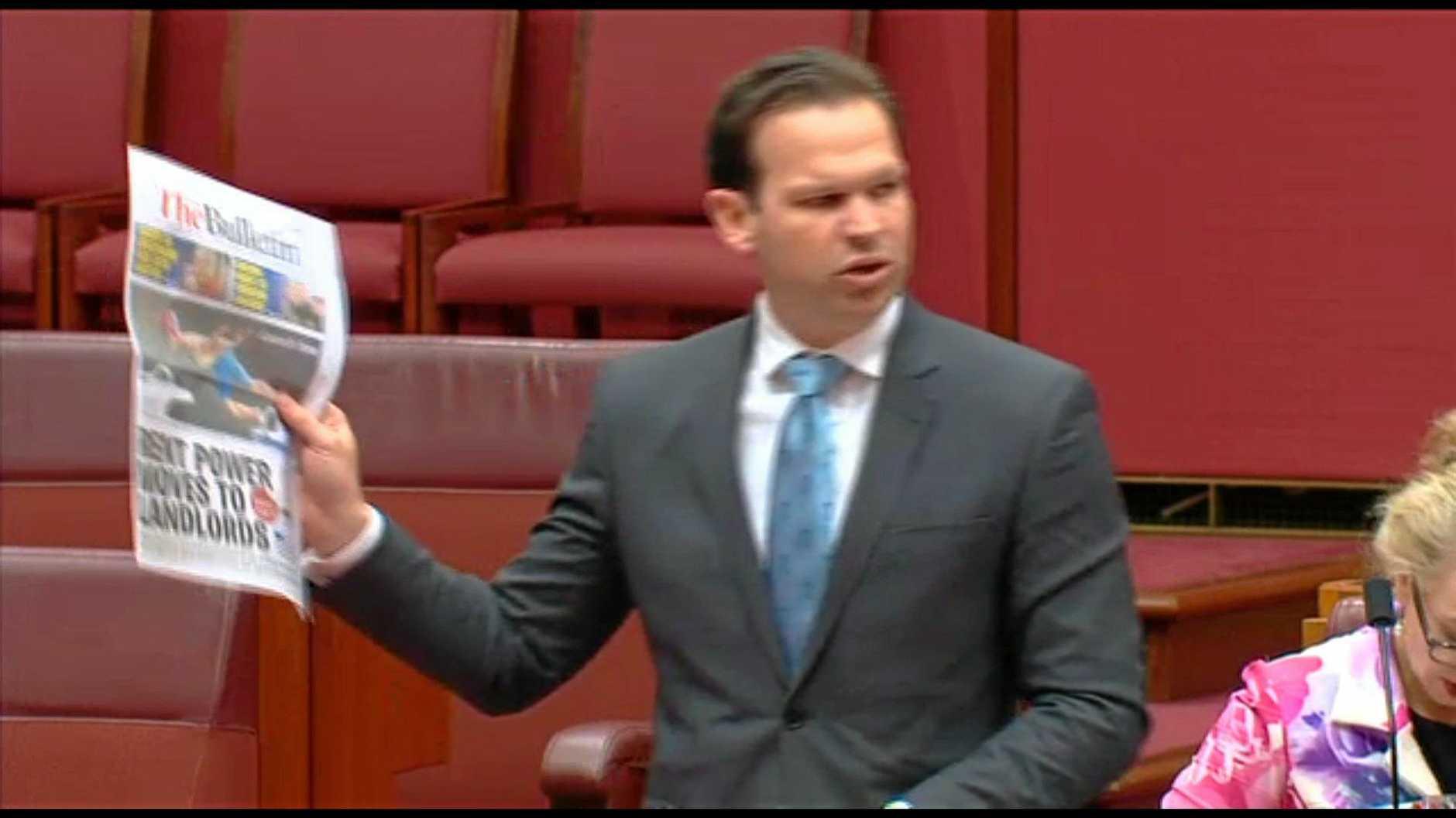 Matt Canavan holding The Morning Bulletin in the Senate.