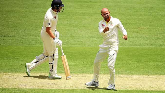 Nathan Lyon celebrates after dismissing Chris Woakes in the first Ashes Test at the Gabba.