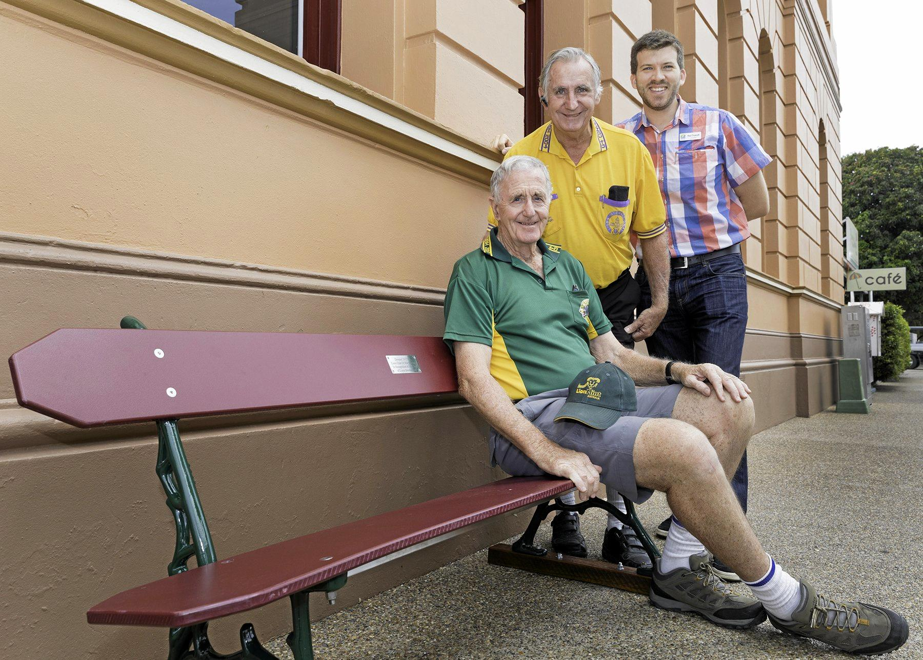 Fraser Coast Councillor Paul Truscott thanks Maryborough Lions Club (left) president John Kelleher and secretary Alan McHardy for the club's donation of buddy benches to celebrate Lions International's 100th anniversary.
