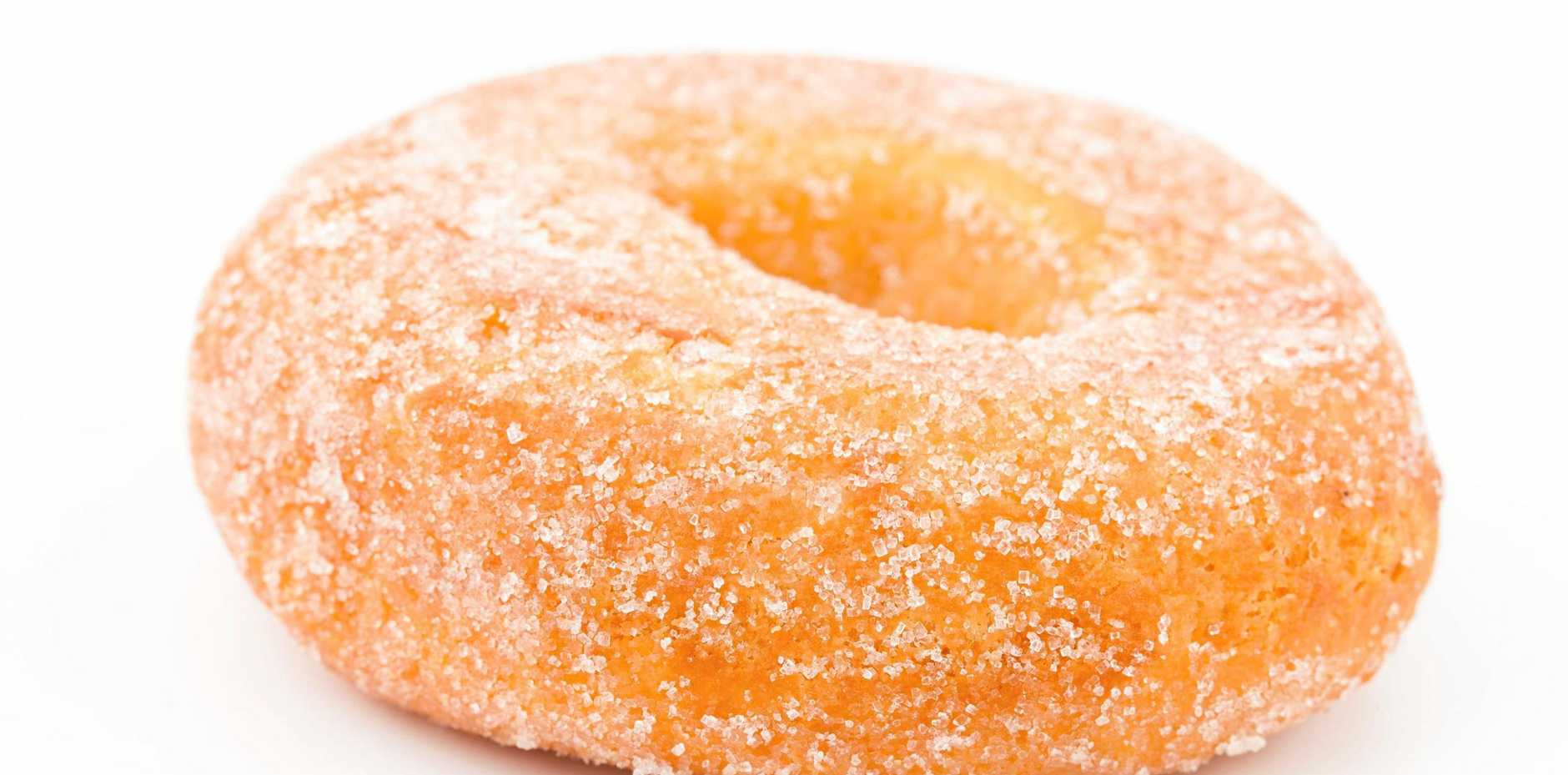 A man responded angrily when a bus passenger complimented his doughnuts.