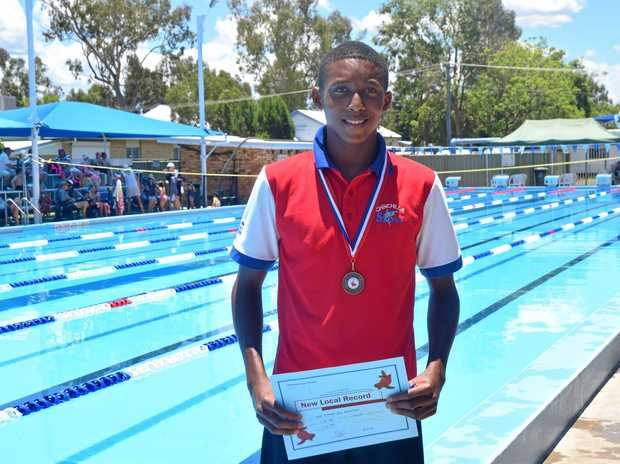 CHINCHILLA SHARK: Enoch Rusford set a local record in 100 metre backstroke at the Chinchilla Open Carnival.