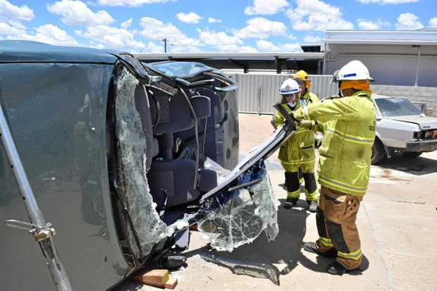 ROLLOVER: The group during a simulation at the Dalby Fire Station on Sunday.