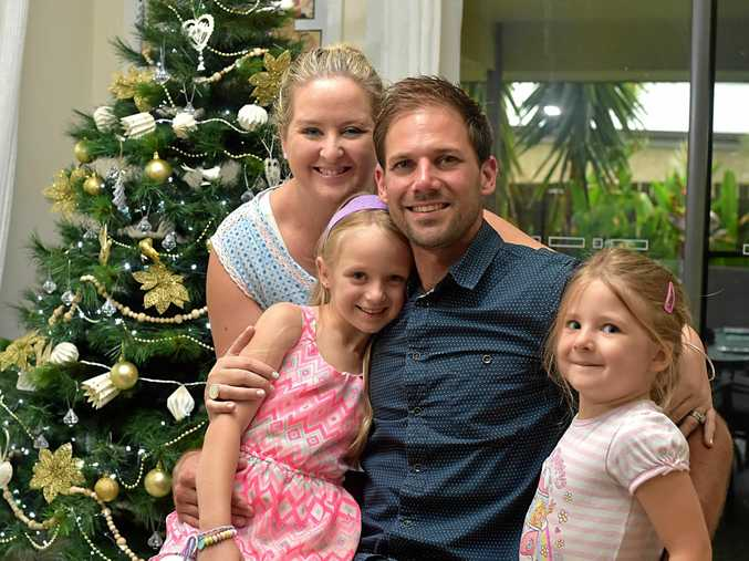 The Butler family from Beerwah looking forward to Christmas after a tough year. Asha and her husband Joel with daughters Emily, 6, and Laura, 4.