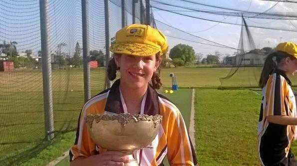 ON A GOOD WICKET: Bonnie Berry holds the trophy won at the State Championships held in Mackay.