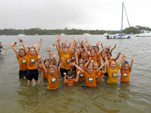 HAPPY DIP: Good Shepherd Lutheran College pre-school class of 2017 celebrate the year's end in Noosa River.