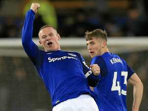 Rooney stuns with strike from own half