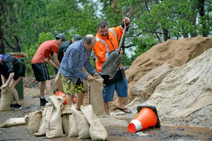 DESPERATE TIMES: Michael Griffiths, and helping out is Chris Scholtz, with sand bagging at Palmwoods SES.