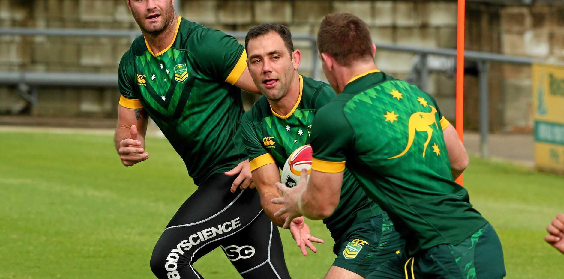 Kangaroos Boyd Cordner, Cameron Smith and Cooper Cronk go through their paces at a training session ahead of the World Cup decider against England.