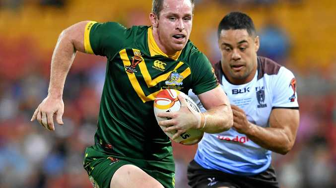 Australia's Michael Morgan gets past Fiji's Jarryd Hayne in their Rugby League World Cup semi-final.