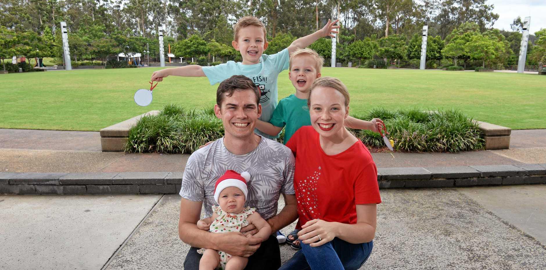 Anthony and Rebekah Sligar enjoy attending the Robelle Domain Christmas Carols with their children Caleb (back left), Zeke, and baby Harper.