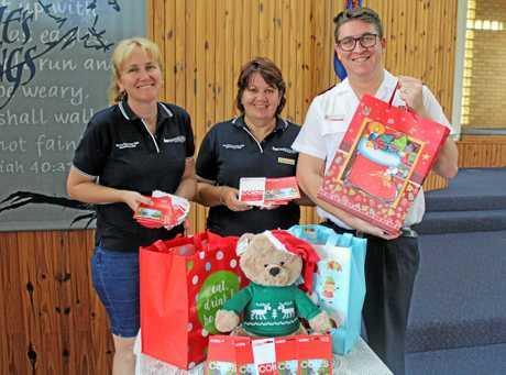 Hervey Bay Lion's Club secretary Michelle Fuchs with president Karen Lancaster and Salvation Army captain Aaron Reid.