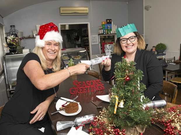 HELPING OTHERS: Toowoomba Hospital Foundation chief executive Alison Kennedy (left) and Annie White from Parisienne Patisserie get ready for Toowoomba's Neighbourhood Christmas Luncheon.