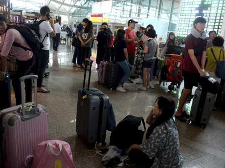 Tourists were left stranded at Ngurah Rai International Airport. Picture: Supplied