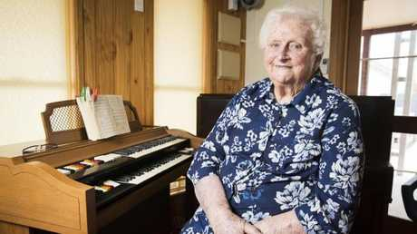 Lady Flo Bjelke-Petersen at the organ where she still plays in the chapel at her retirement home in Kingaroy. Picture: Lachie Millard