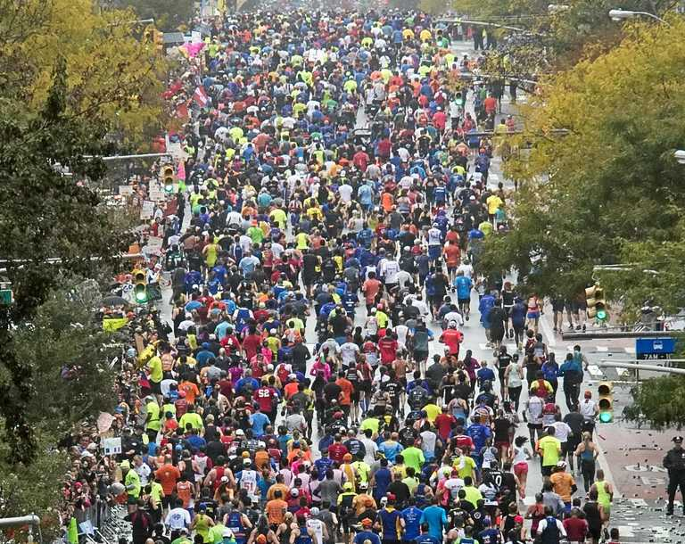 Runners move along First Avenue during the New York City Marathon on November 5.