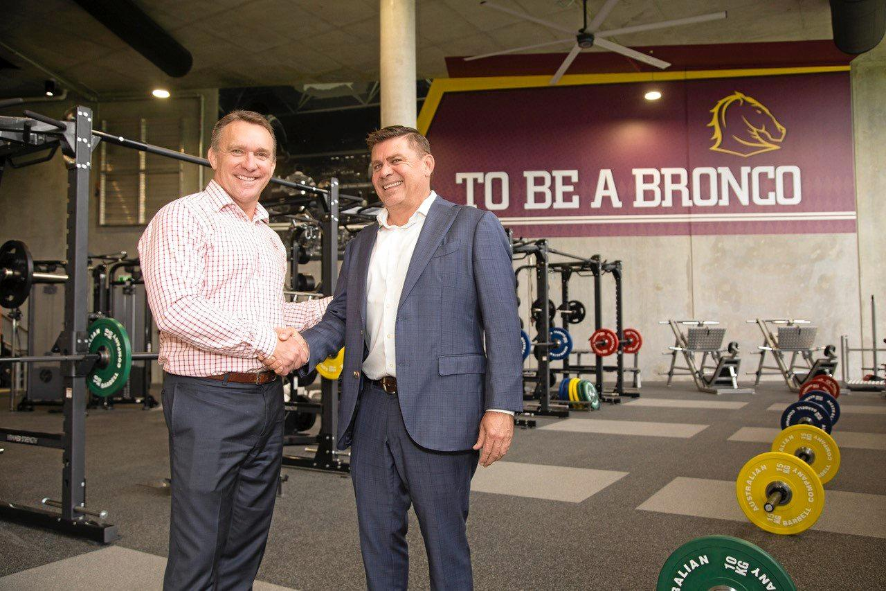 HORSEPOWER: Brisbane Broncos boss Paul White with Llewellyn Motors principal Wade Llewellyn, who sealed a new sponsorship deal at the new Broncos training facility this week.