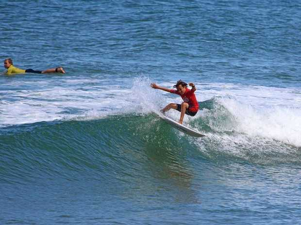Byron Bay Boardriders grom Touma Cameron taking out the under 14 division of the Woolworths Surfer Groms.
