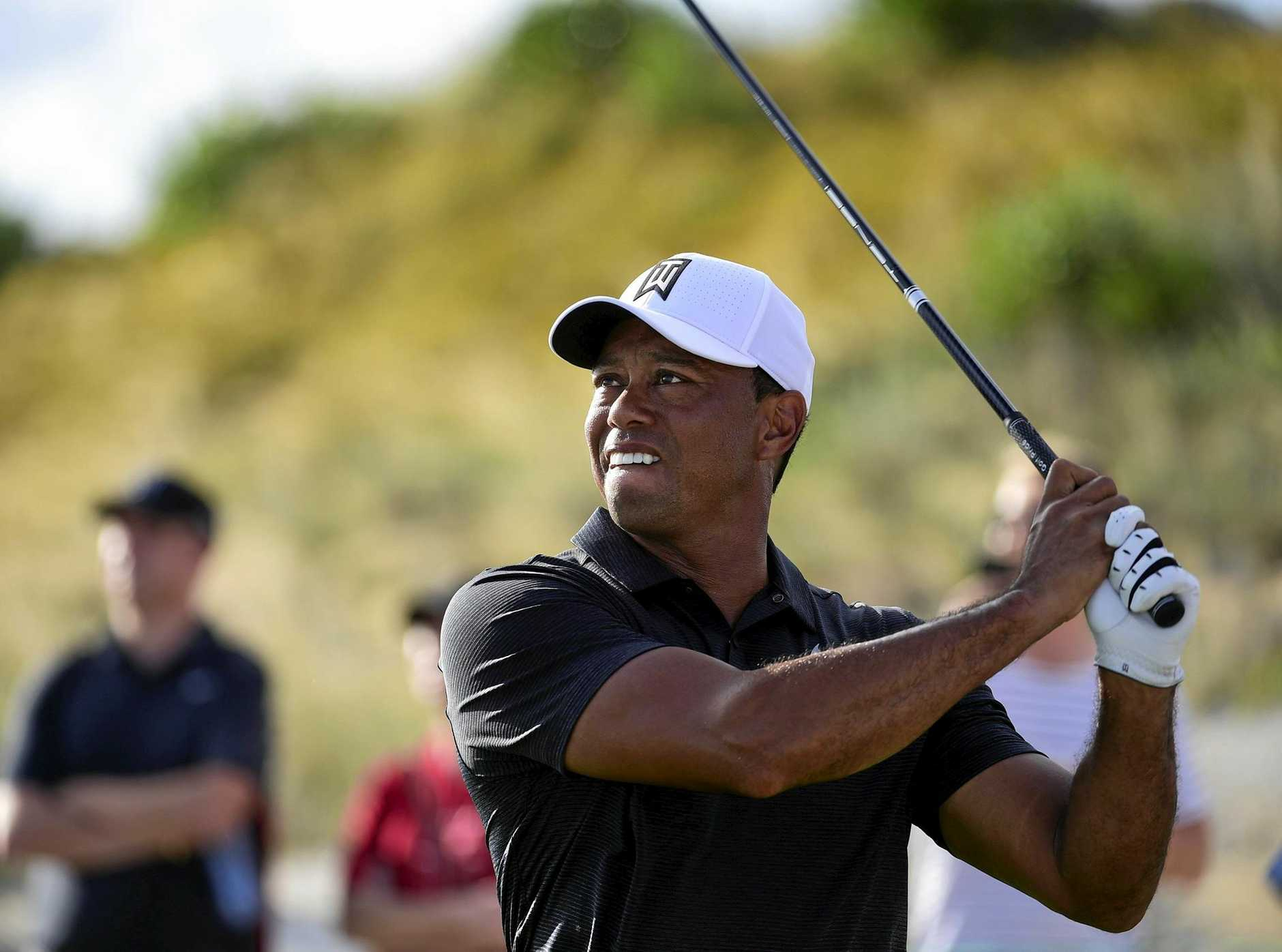 Tiger Woods tees off at the 16th in the first round of the Hero World Challenge golf tournament at Albany Golf Club in Nassau, the Bahamas.