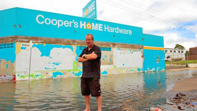 TIME FOR CHANGE: Cooper's Hardware owner Stephen Cooper (pictured here after the 2011 floods) has decided to close his business after 25 years.