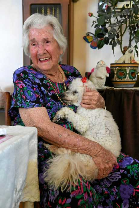 Nancy McCarthy with her dog Honey. Nancy sat on Santa's knee for the fist time at the age of one hundred and one.